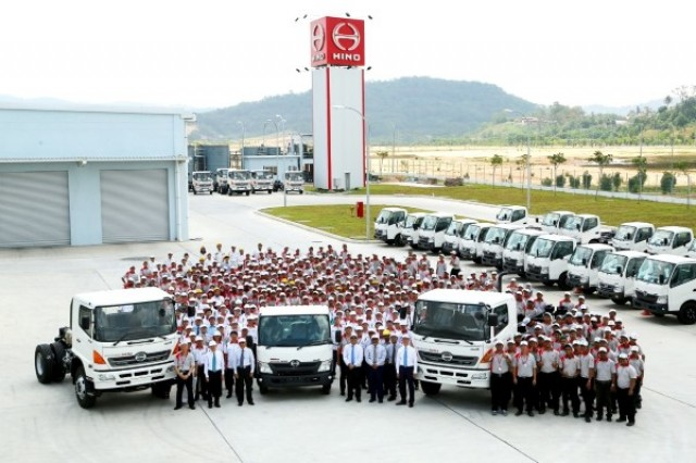 Staff and guests pose with made-in-Sendayan HINO trucks after the plant's official line-off ceremony