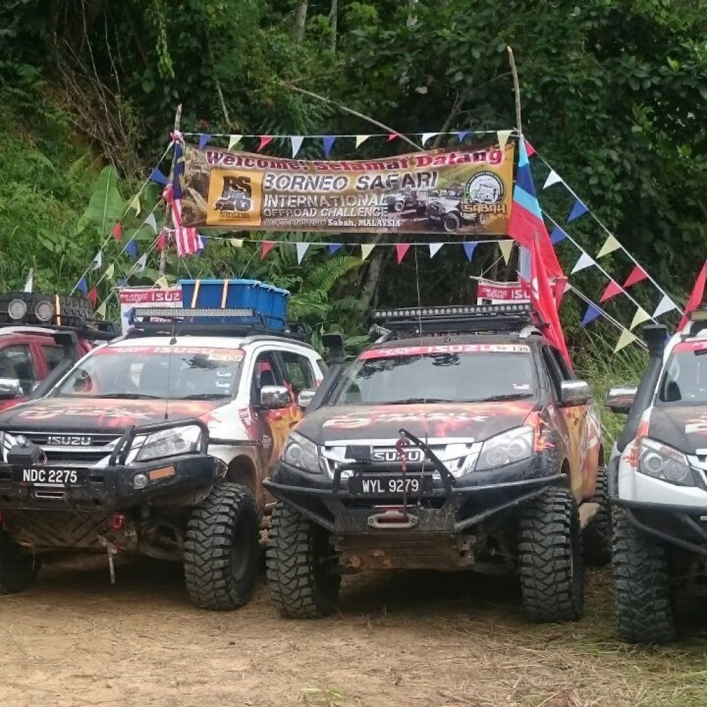The four units of Isuzu Media Team cars comprised the mu-X (second left)...