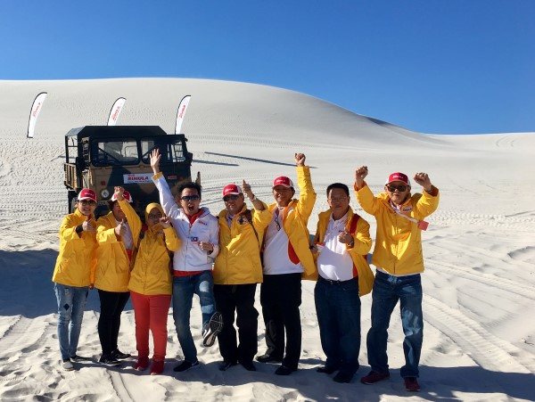 Shell Rimula Global Promotions winners at a sand dune outside Cape Town