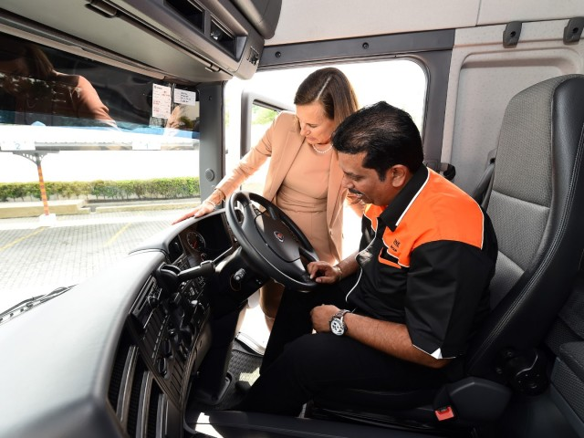 2_Scania Southeast Asia Managing Dire ctor, Marie Sjödin Enström showing AONE Group Managing Director, S. Palani the features of the Scania truck
