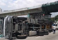 Truck topples along PLUS highway